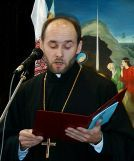 Father Andrzej Los reads the words of HE Bishop Abel